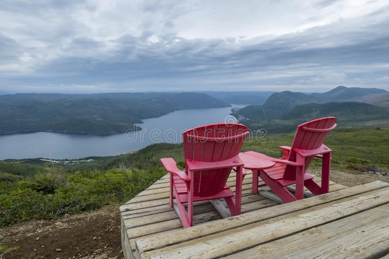 Two Red Adirondack Chairs With a Grand Vista #2 royalty free stock images