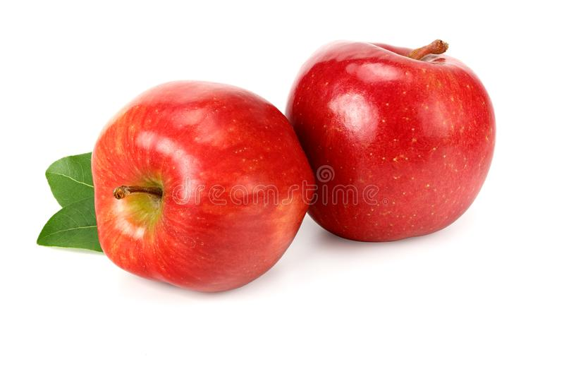 Two red apples with green leaves isolated on white background royalty free stock photos