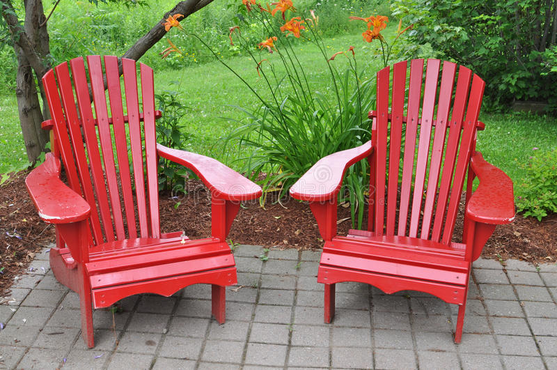 Two red chairs. In the garden royalty free stock image
