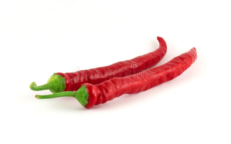 Two red chilli paprikas stock images
