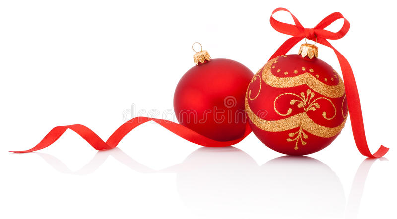 Two Red christmas decoration balls with ribbon bow isolated. On white background stock images