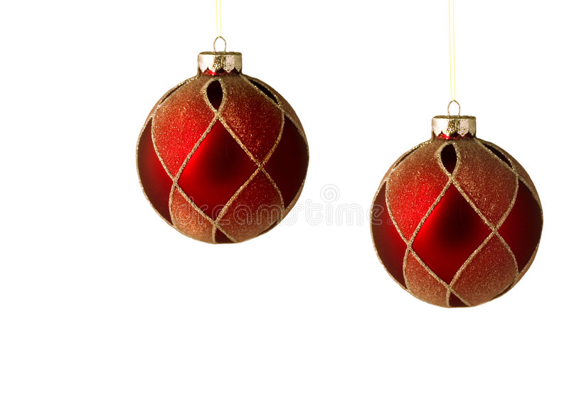 Two red christmas ornaments isolated stock images