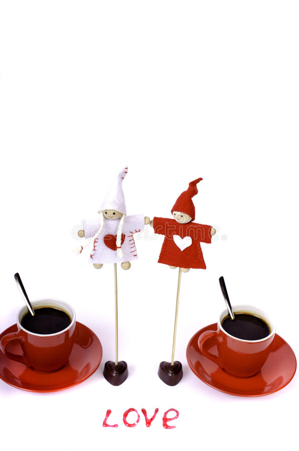 Two red coffee cups, toys, the words royalty free stock photography