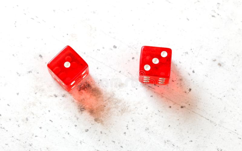 Two red craps dices showing Easy Four number 1 and 3 overhead shot on white board.  royalty free stock photo