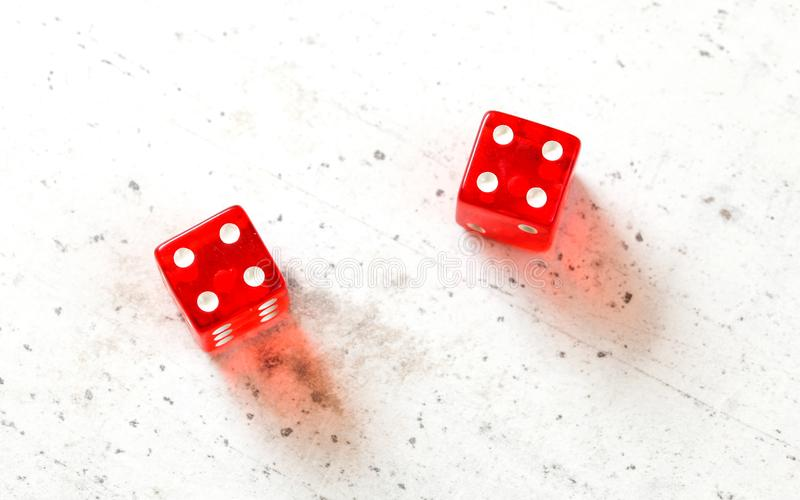 Two red craps dices showing Hard Eight from Decatur double number four overhead shot on white board.  stock photos