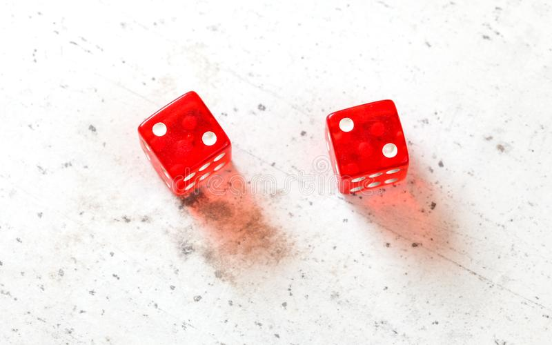 Two red craps dices showing Hard Four / Little Joe double number two overhead shot on white board.  stock image