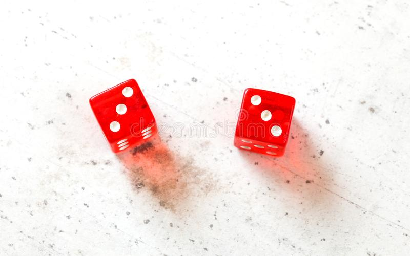 Two red craps dices showing Hard Six double number three overhead shot on white board.  royalty free stock photo