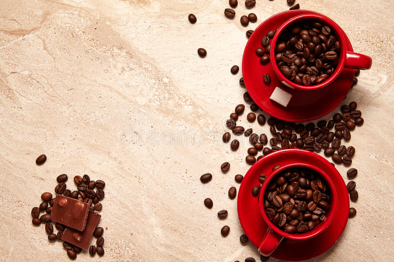 Two red cups of coffee, chocolate . royalty free stock images