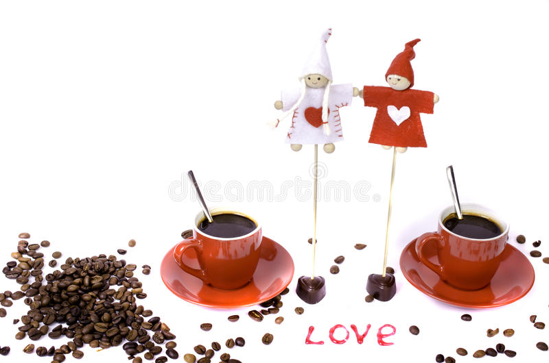Two red cups of coffee, coffee beans and chocolate hearts. stock images