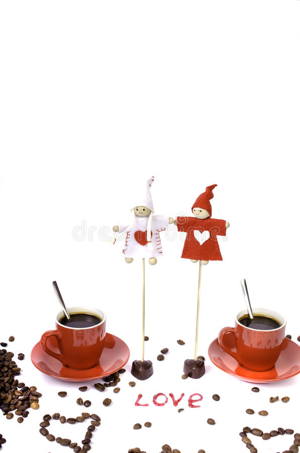 Two red cups of coffee, coffee beans and chocolate hearts. stock photography