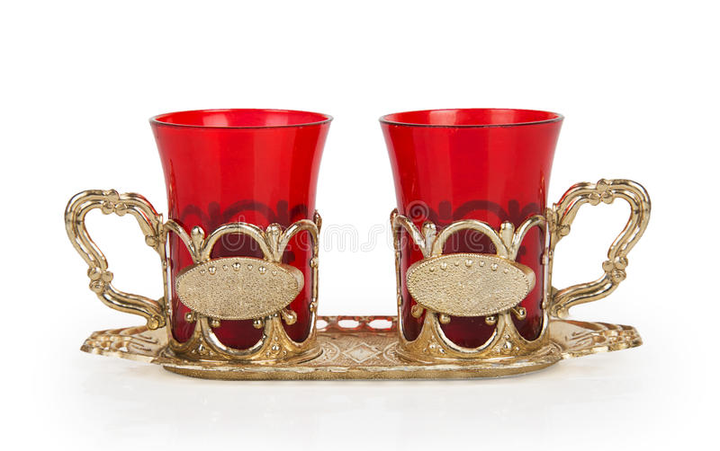 Two red cups on a yellow metal stand royalty free stock image