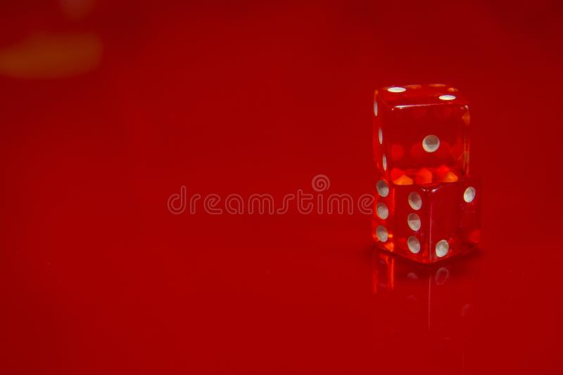 Two Red dice on bright red glossy background. stock photo