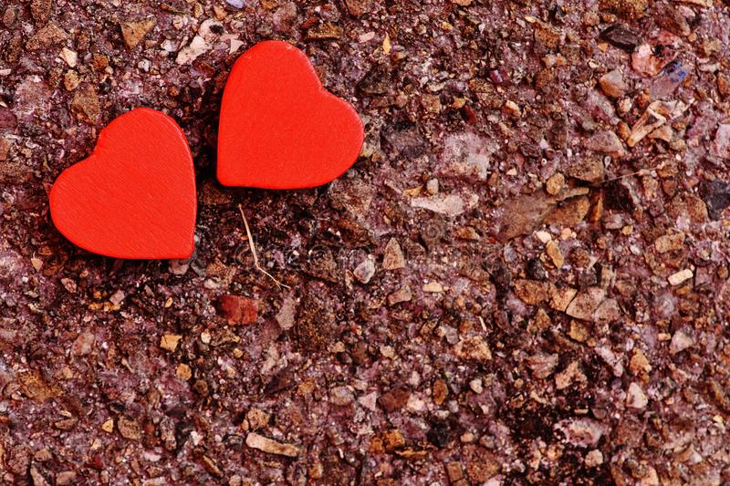 Two Red Heart Decoration on Ground royalty free stock image