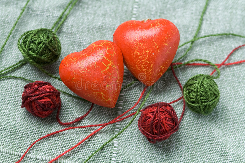Download Two Red Heart Shapes And Four Cotton Clew Balls Stock Photo - Image: 7581794