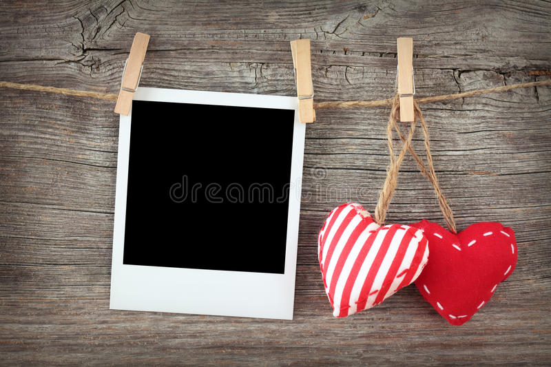 Two Red Hearts And Blank Instant Photo Royalty Free Stock Image