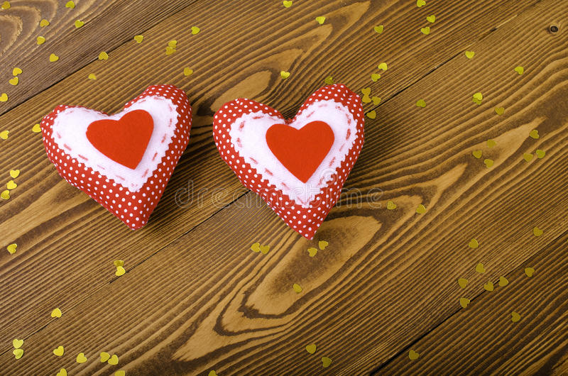 Two red hearts close up. stock image