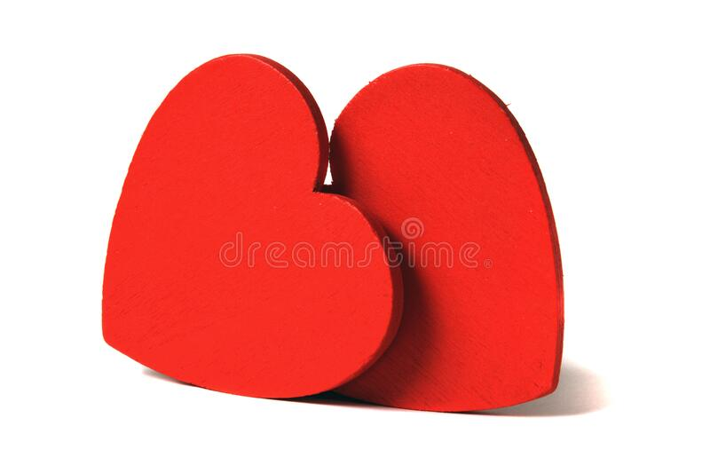Two red hearts. Isolated on white royalty free stock images
