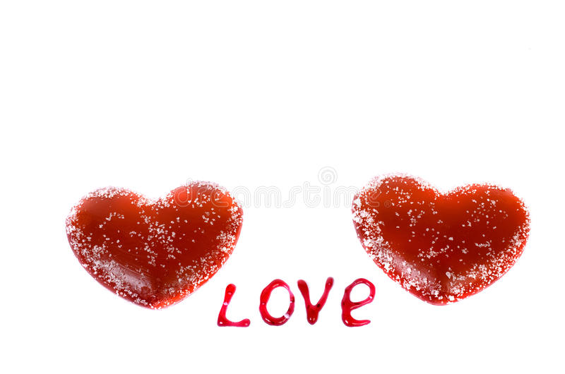 Two red hearts on a white background and the words royalty free stock image