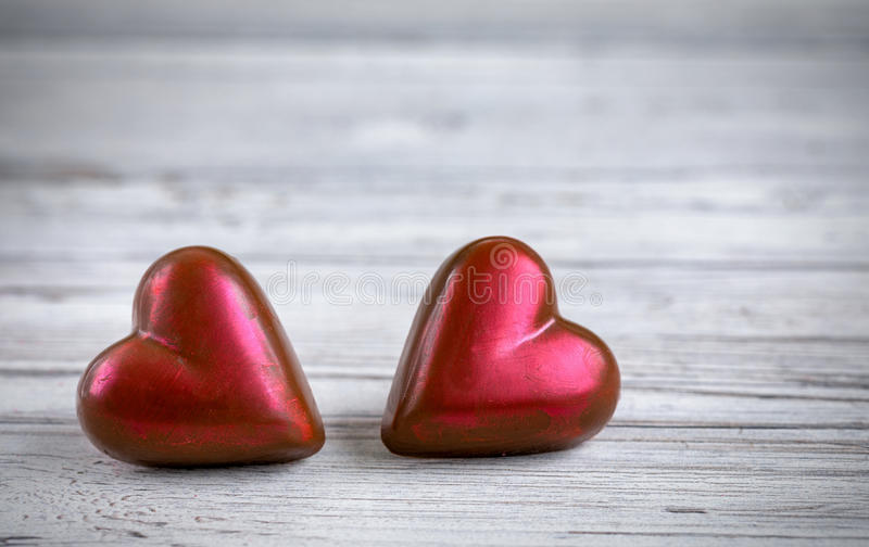 Two red hearts on white vintage wooden background. For valentines day royalty free stock photo
