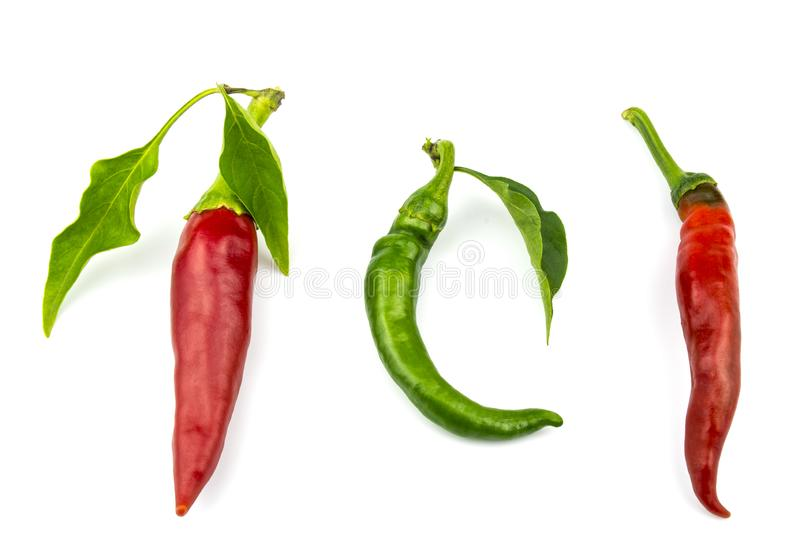 Two red hot chili peppers and one bent isolated on a white background. royalty free stock photography