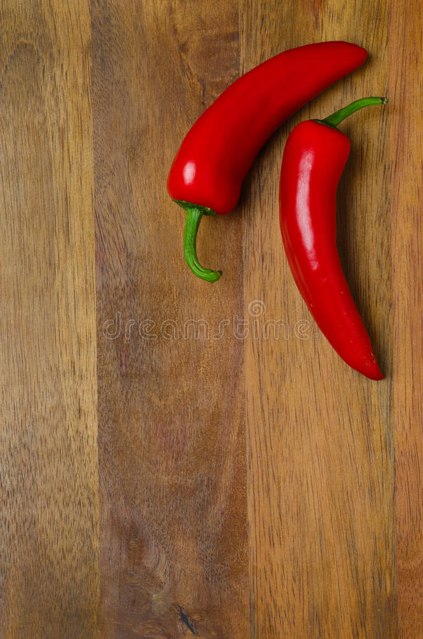 Download Two Red Hot Chili Peppers On A Wooden Background Stock Image - Image of fresh, aroma: 31641847
