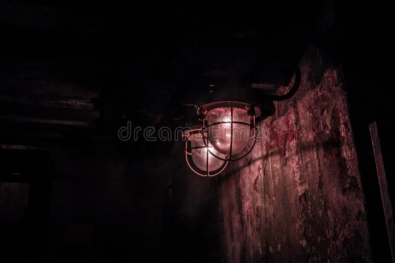Two red umbrellas from the sun. Two red lanterns, like from a horror movie. Dark room. a little fear. in dark room. red light. great background for your phone stock images