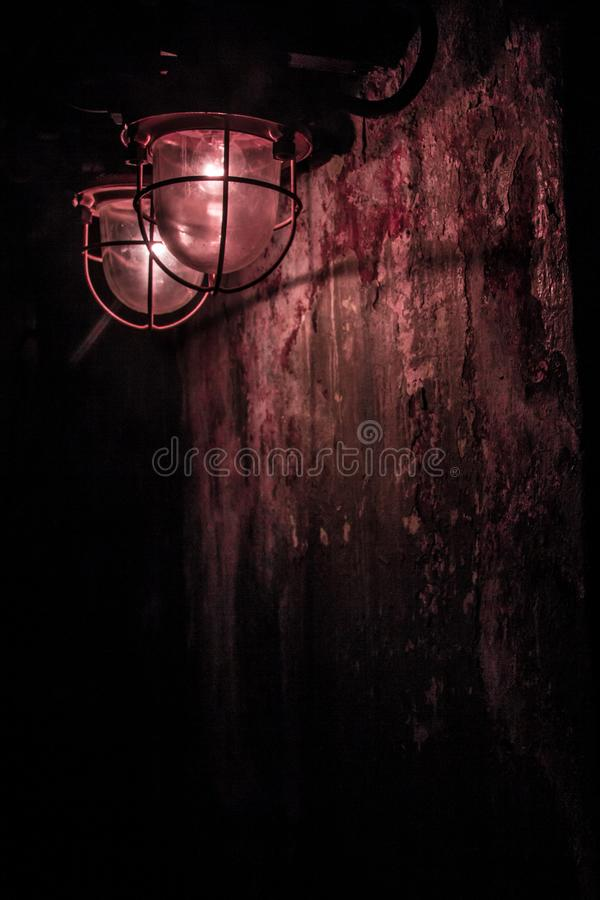 Two red lanterns,. Like from a horror movie. Great screensaver on your smartphone. phone background. a little bit of horror. illuminating the darkness royalty free stock images
