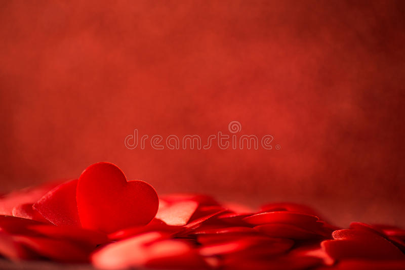 Two red satin hearts on red background, valentines or mothers day background, love celebrating stock photography