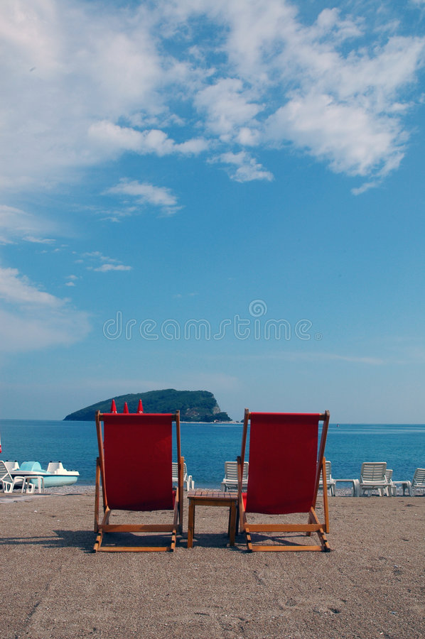 Two Red Seats At The Bich Royalty Free Stock Image