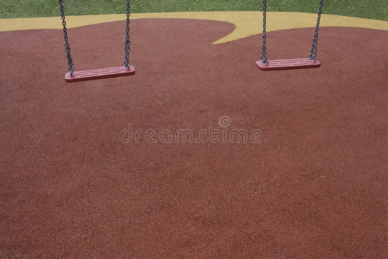 Two red swings royalty free stock image