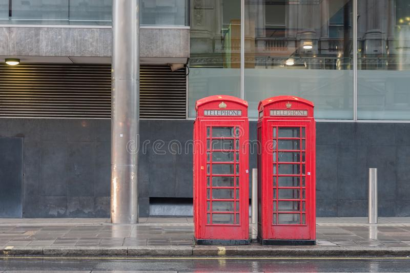 The two red telephone boxes , famous icons of London,. On Pall Mall street, England stock image