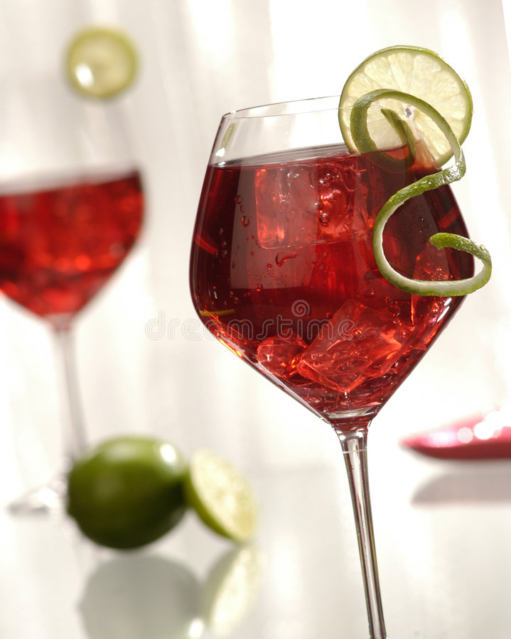 Two red wine cocktails stock photography