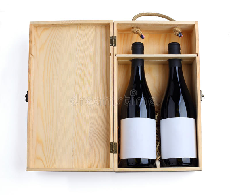 Two red wine in a wood case royalty free stock image