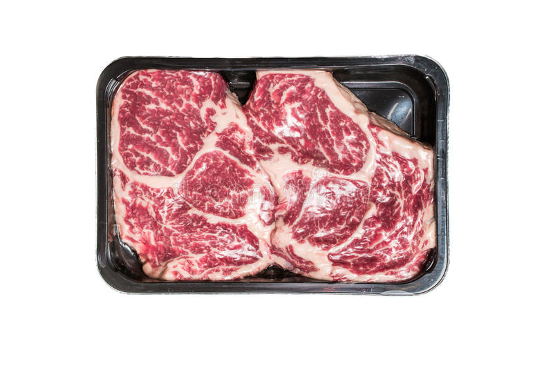 Two ribeye steaks in vacuum package stock photography