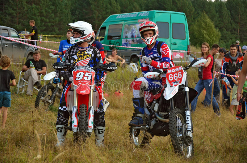 Two riders to sit on a motorcycle enduro royalty free stock image