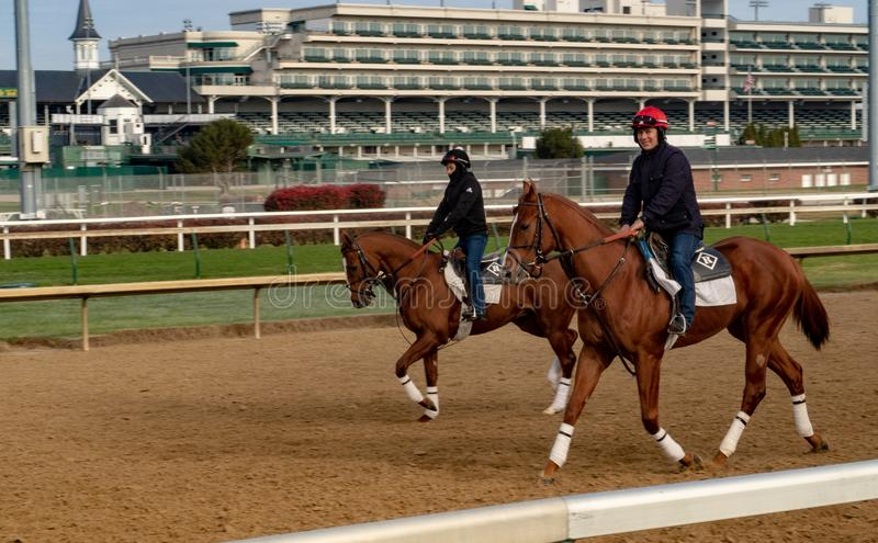 Riders on Race Horses at Churchill Downs. Two riders warming-up race horses at Churchill Downs in Louisville, Kentucky royalty free stock images