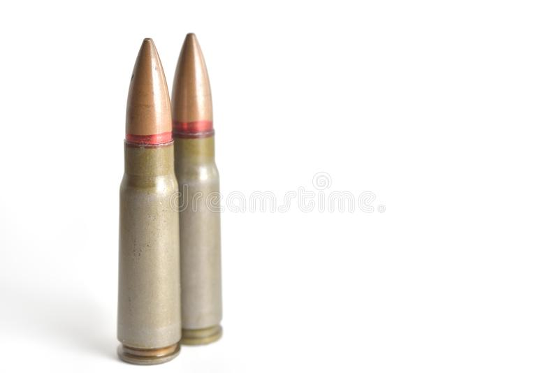 Two rifle bullets isolated on a white background. Military ammunition royalty free stock photos