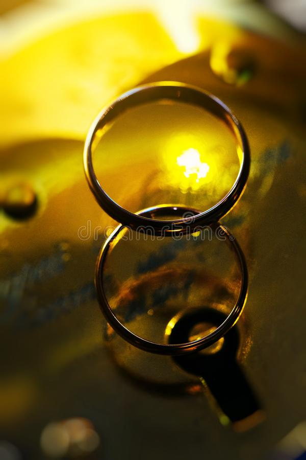 Two rings of wedding close up. Two rings of happy wedding close up with yellow background royalty free stock photo