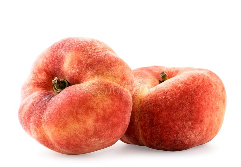 Two flat peaches on a white background, isolated. royalty free stock photography