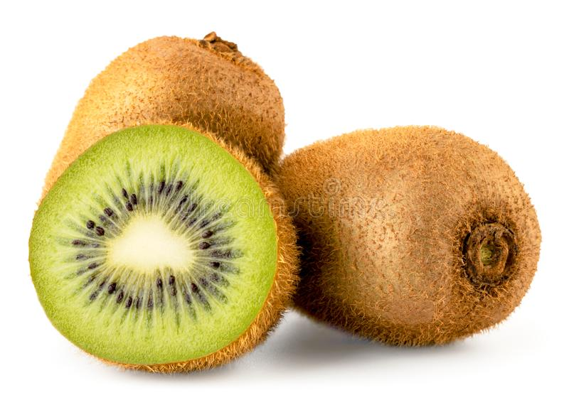 Two ripe kiwis and half close up on a white. Isolated. stock photography