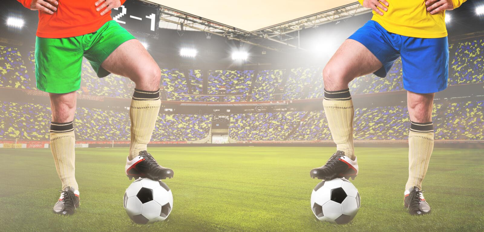 Two rival soccer or football players. Are standing on stadium royalty free stock image