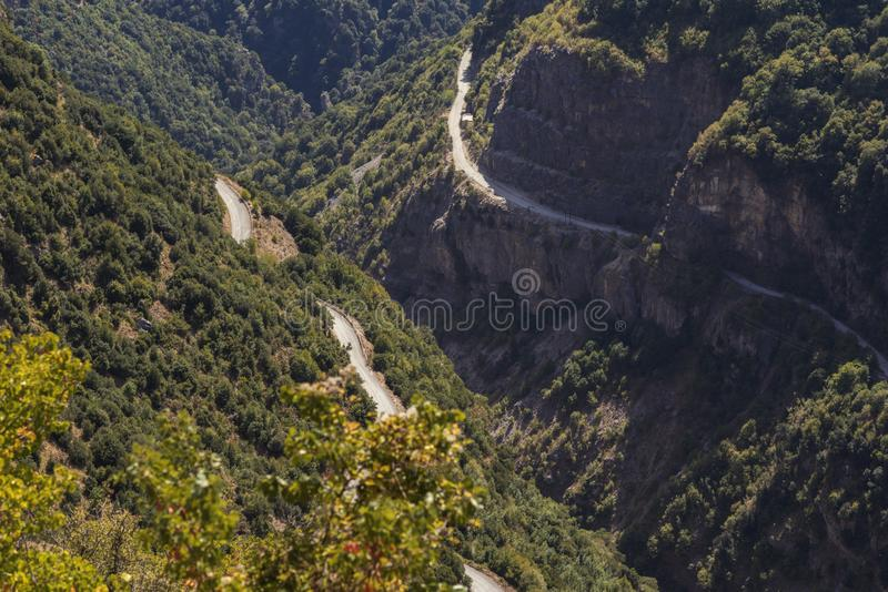 Two roads in the mountain in National Park of Tzoumerka, Greece Epirus region. Mountain in the clouds royalty free stock image