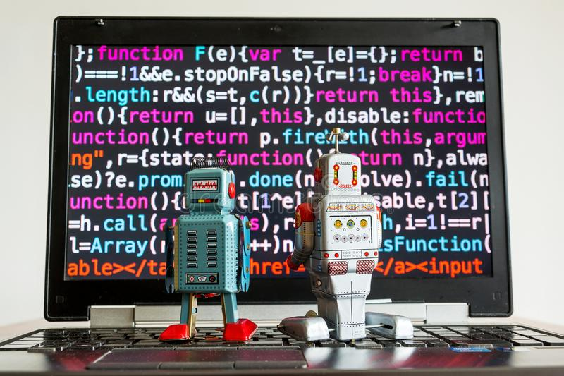 Robots with source code screen, artificial intelligence, deep learning concept royalty free stock image