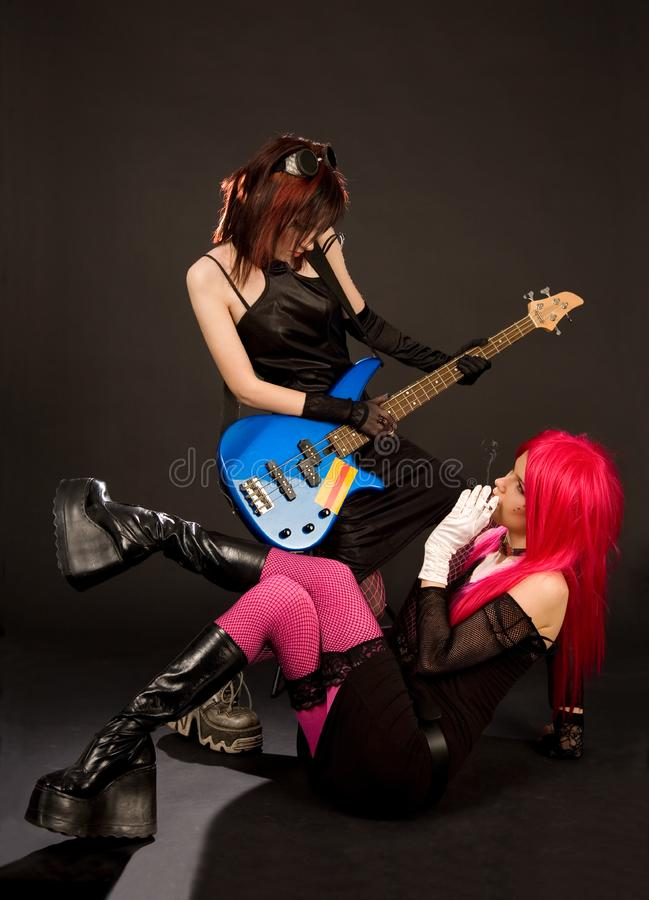 Two rock girls looking at each other royalty free stock photo