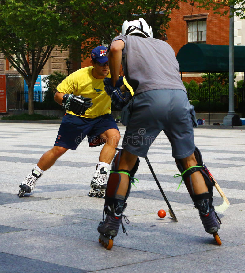 Two roller in-line hockey players in Washington. Washington D.C., USA - August 15, 2015: two young men play roller in-line hockey outdoor. Two teams were playing stock photos