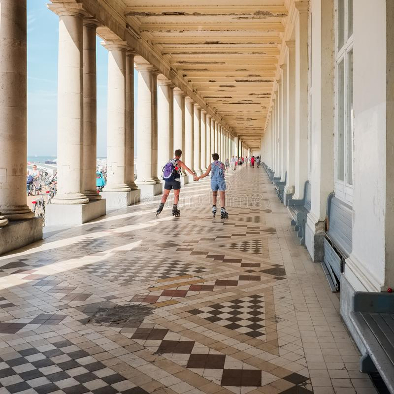 Free Two Roller Scaters In The Royal Galleries In Oostende, Stock Images - 121799624
