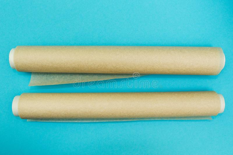 Two rolls of parchment paper on a blue background stock photography