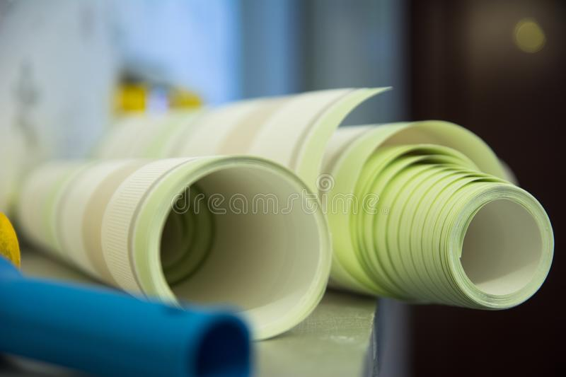 Two rolls of striped wallpaper vinyl for room repair.  royalty free stock photography