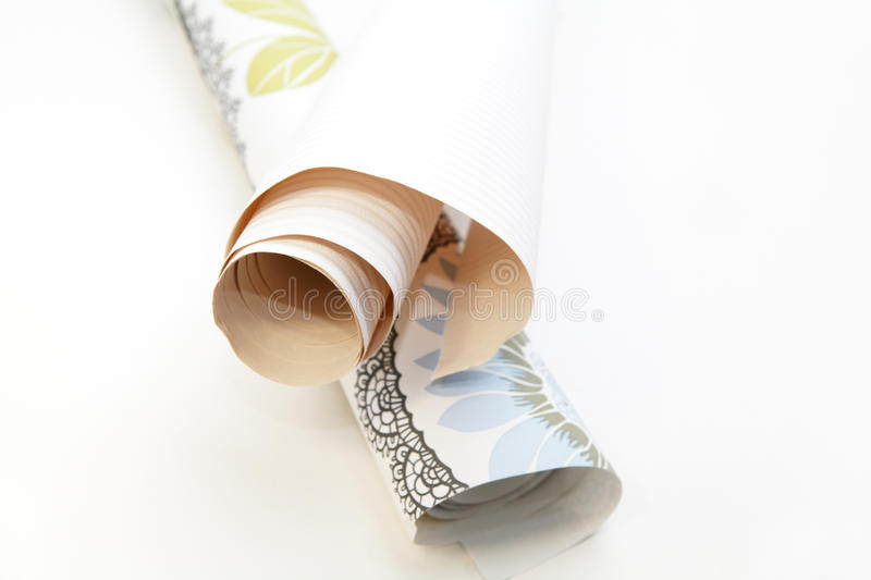 Two rolls of wallpaper. Two different rolls of wallpaper indoors stock photos