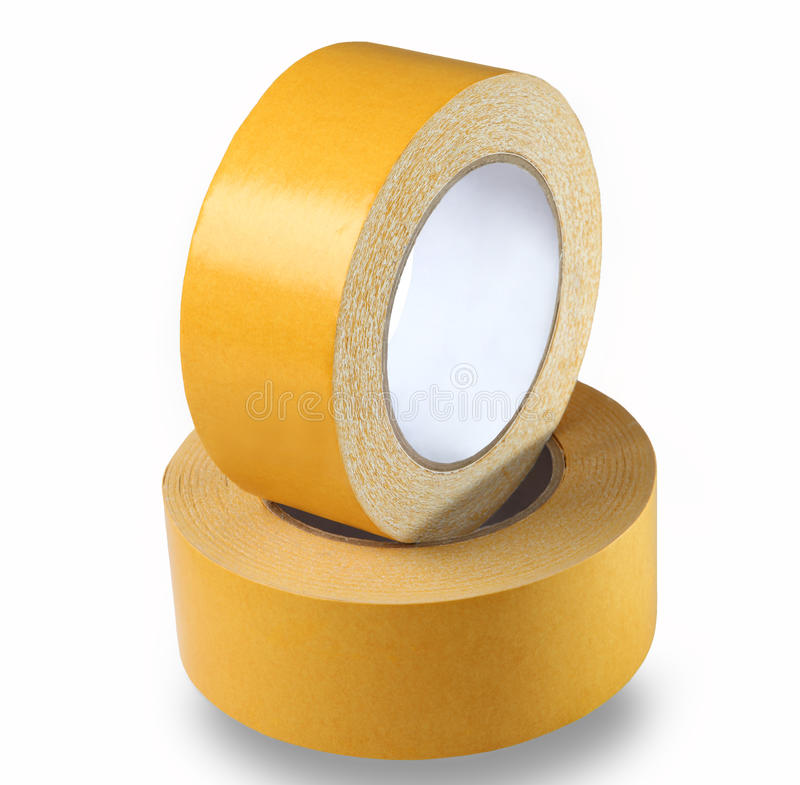 Two rolls of yellow double-sided tape on a white background, iso stock photo